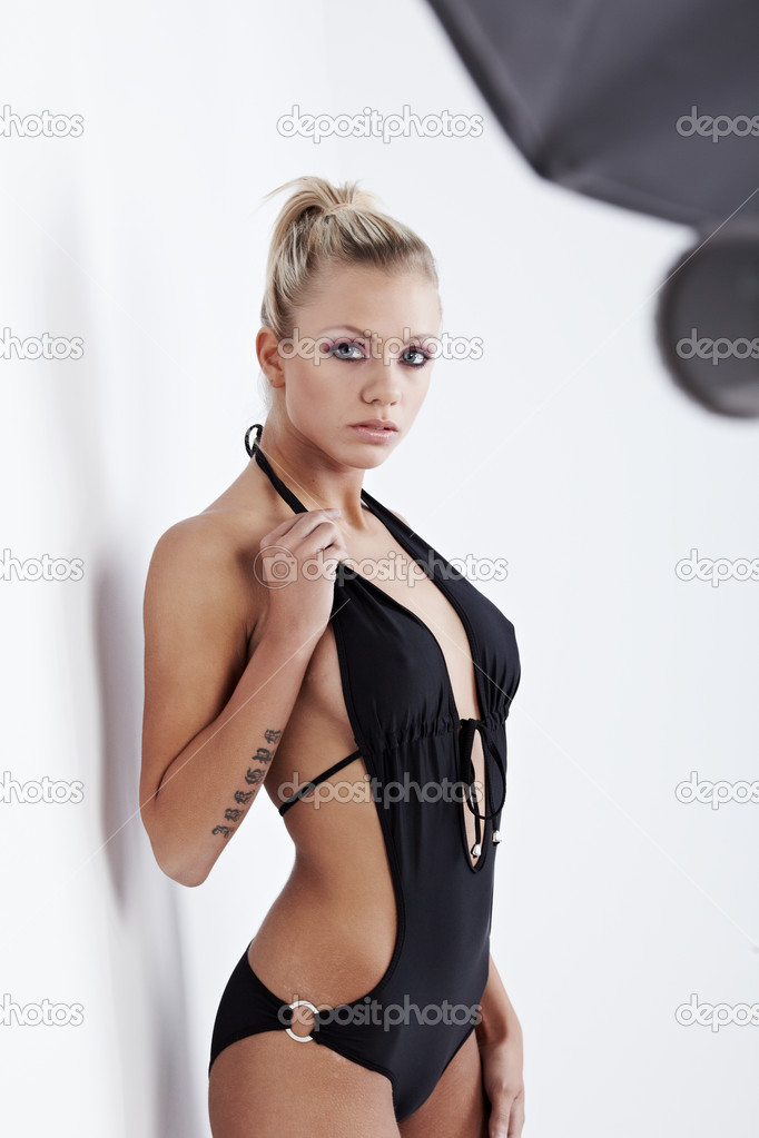 Sexy model wearing black bikini on white isolated background - Stock ...