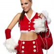 Happy cute girl in santa claus suit with gift bag over white — Stock Photo
