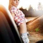 Beautiful sexy woman with white luxury car — Stock Photo