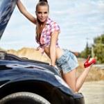 Beautiful young woman repairing the car — Stock Photo