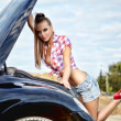 Beautiful young woman repairing the car — Stock Photo #6652748