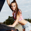 Beautiful young woman repairing the car - 