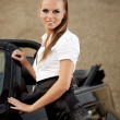 Fashion vintage woman with cabrio car — Stock Photo
