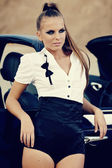 Young sexy woman with car — Stock Photo