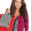 Beautiful, young woman with colorful shopping bags — Stock Photo #6683402