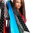 Beautiful, young woman with colorful shopping bags — Stock Photo #6683514