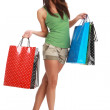 Sexy young woman with colorful shopping bags — Stock Photo