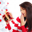 Beautiful woman with gift next to white christmas tree — Stock Photo #6688803