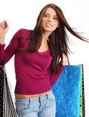 Vacker, ung kvinna med färgglada påsar — Stockfoto
