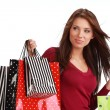 Beautiful, young woman with colorful shopping bags — Stock Photo #6699730
