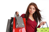 Beautiful, young woman with colorful shopping bags — Stock Photo