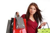 Piękna, młoda kobieta z kolorowe torby na zakupy — Zdjęcie stockowe