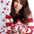 Young Woman decorating white christmas tree — Stock Photo #6700465