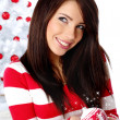 Young Woman decorating white christmas tree — Stock Photo #6700558