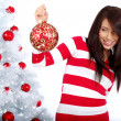 Young Woman decorating white christmas tree — Foto Stock