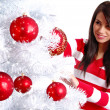 Young Woman decorating white christmas tree — Stock Photo #6700713