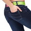 Closeup photo of a slim woman's abdomen and jeans with measuring — Stock Photo