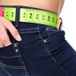 Closeup photo of a slim woman's abdomen and jeans with measuring — Stok fotoğraf