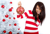 Young Woman decorating white christmas tree — Stok fotoğraf