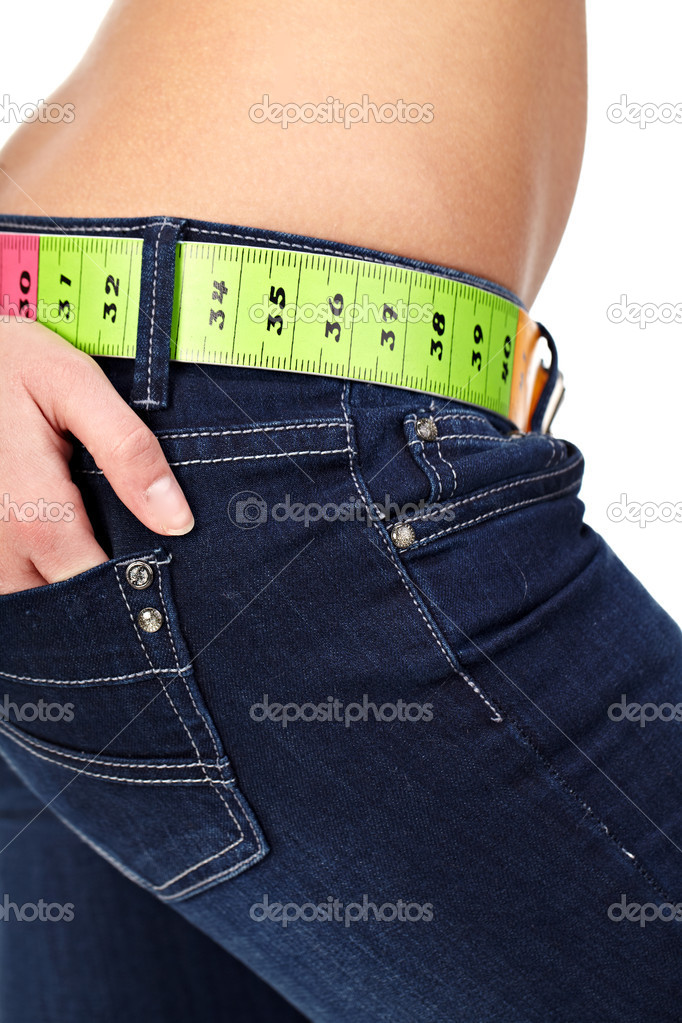 Closeup photo of a slim woman's abdomen and jeans with measuring tape instead of a belt. — Stock Photo #6704043