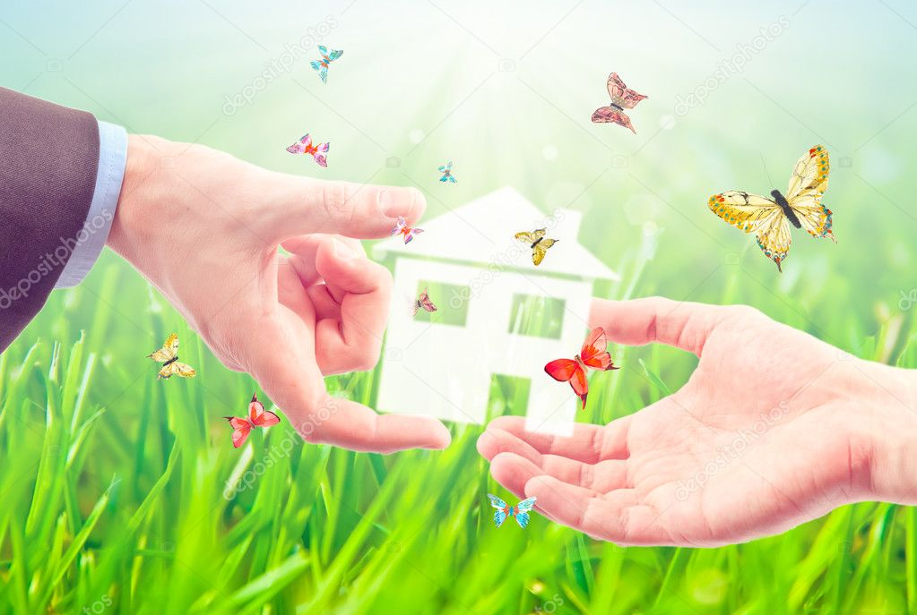 The House in the hands against the blue sky as a symbol of the real estate business. — Stock Photo #5584794