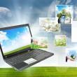 Stock Photo: Laptop against green nature background