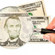 Magnifying glass and money — Stock Photo