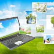 Royalty-Free Stock Photo: Laptop against green nature background