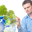 Stock Photo: Caucasian businessman drawing tree on the Earth
