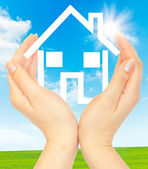 Hands holding model of a house — Stock Photo