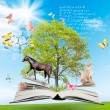 Stock Photo: Magic book with green tree and diferent animals