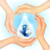 Drop of water with Earth inside — Stock Photo