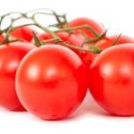 Tomatoes on a white — Stock Photo
