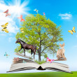 Royalty-Free Stock Photo: Magic book with a green tree and diferent animals