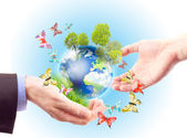 The earth in human hands — Stock Photo