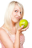 Beautiful blonde girl with fresh green apple — Stock Photo