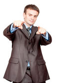 Businessman pointing fingers at viewer — Stock Photo
