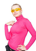 Beautiful blonde in the yellow glasses. — Stock Photo