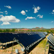 Solar panels in Utah under blue sky - Stock Photo