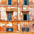 Stock Photo: Old brick wall with windows