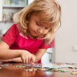 Girl, playing puzzles — Stock Photo