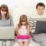 Happy family with laptop — Stock Photo #5986892