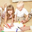 Stock Photo: Parents with children the drawing