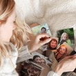 Young woman, tearing photo - Stockfoto