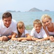 Family on the beach — Stock Photo #5987032