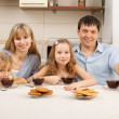 Happy family drinks tea — Stock Photo #5987181