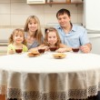 Happy family drinks tea — Stock Photo #5987184
