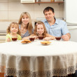 Happy family drinks tea — Stockfoto