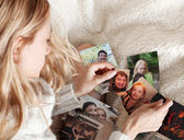 Young woman, tearing photo — Stock Photo