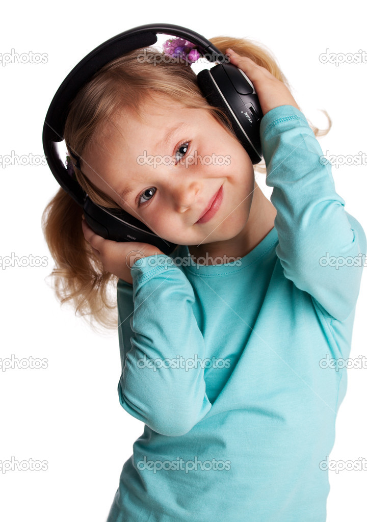 Little child in headphones isolated on white  Stock Photo #5986934